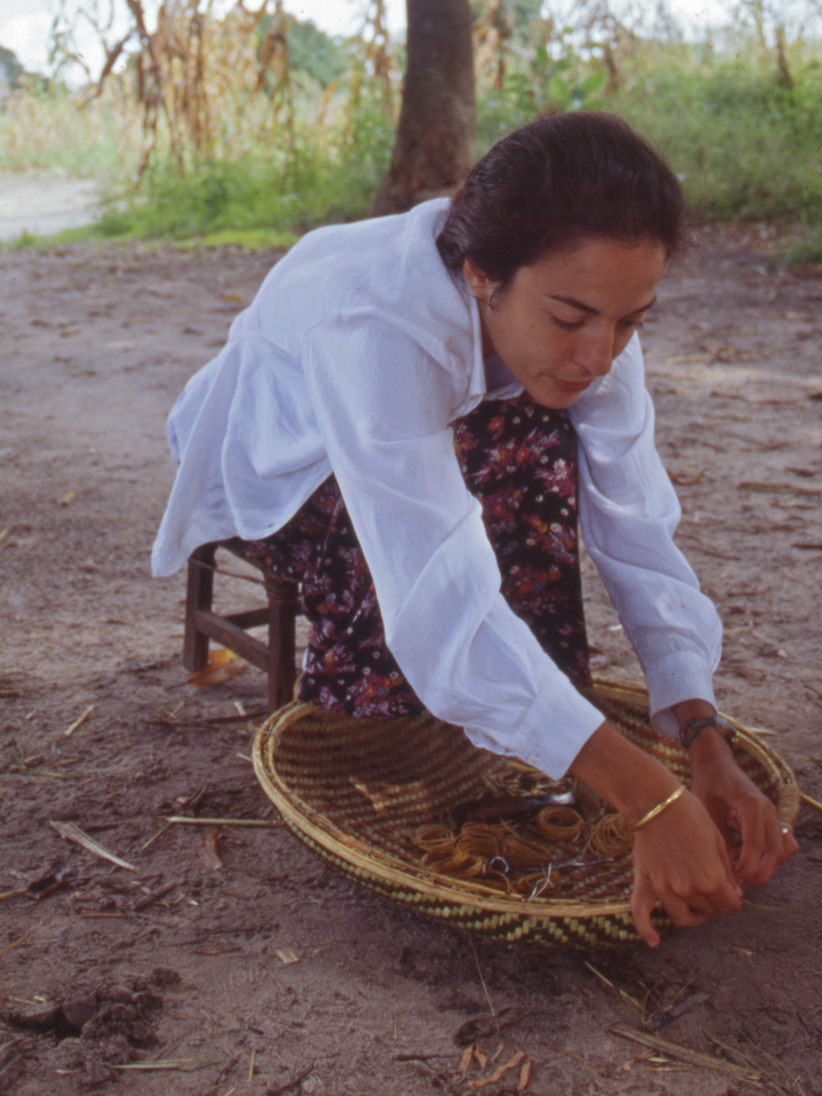 author working on the rim of one of vaMutondo's winnowing trays
