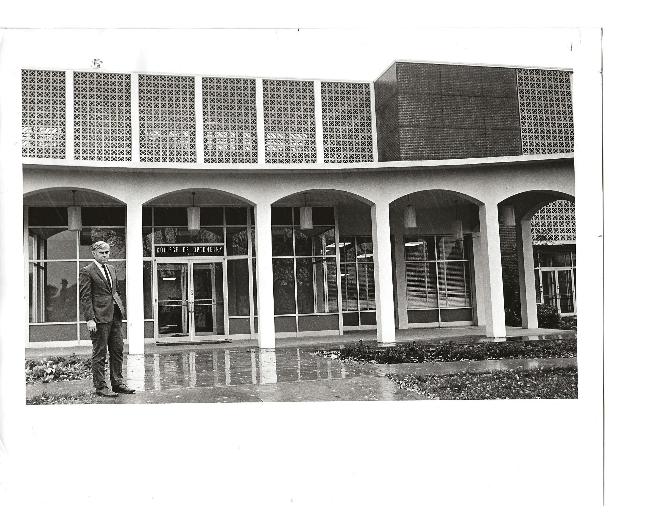 Bradford W. Wild, OD, standing in front of Jefferson Hall, home of the Pacific University College of Optometry, in 1970.