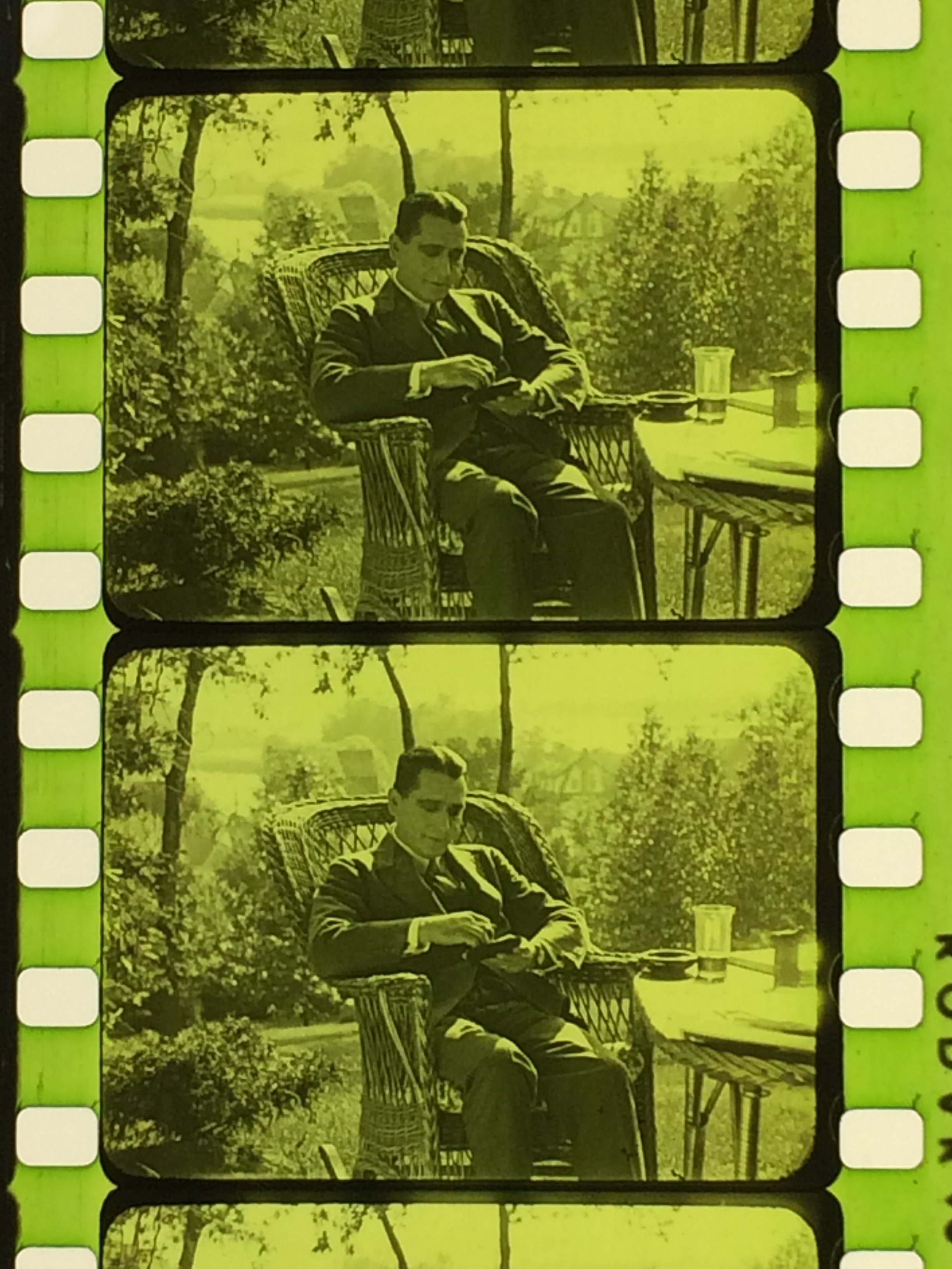 """Image of frame of 1926 movie """"Through Life's Windows"""" with green tint"""