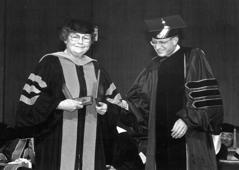 Black and white photo of Dr. Ruth Morris and Dean Richard M. Hill, O.D. at The Ohio State University in 1991
