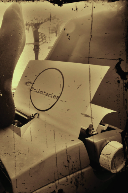 2013 Cover Image-Tributaries sepia-tone image of paper and typewriter.