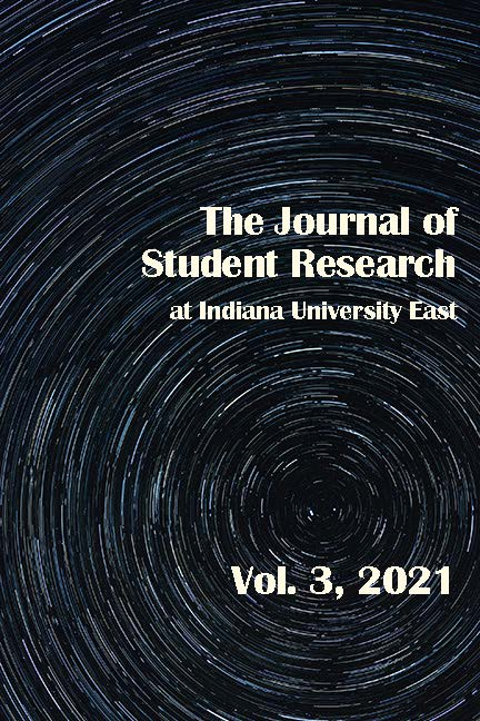 JSRIUE Cover image- Star-field image exposed over time, black, gray, and white tones with white printing